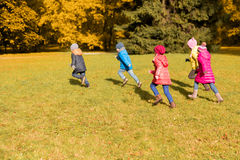 Group of happy little kids running outdoors Stock Photo