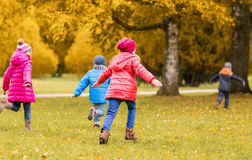 Group of happy little kids running outdoors Stock Photography