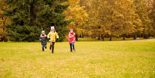 Group of happy little kids running outdoors Royalty Free Stock Image