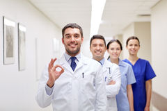 Group of happy medics or doctors at hospital Stock Photos