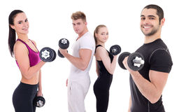 Group of happy men and women in sportswear doing exercises with Stock Photography