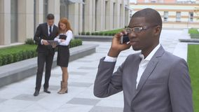 Group Of Happy Multiracial Businesspeople. African American speaking on the phone stock video