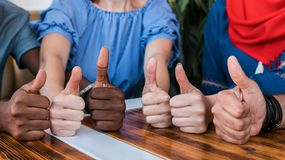 Group of happy multiracial friends thumbs up. royalty free stock photos