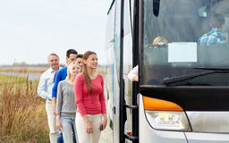 Group of happy passengers boarding travel bus Stock Images