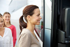 Group of happy passengers boarding travel bus Stock Photos