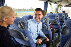 Group of happy passengers in travel bus. Transport, tourism, road trip and people concept - group of happy passengers or tourists in travel bus Royalty Free Stock Image