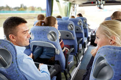 Group of happy passengers in travel bus Stock Image