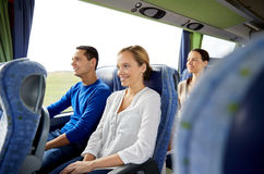 Group of happy passengers in travel bus Royalty Free Stock Images