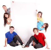 Group of happy people with banner. Stock Photos