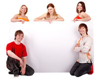 Group of happy people with banner. Stock Images