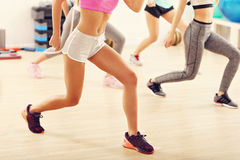 Group of happy people with coach dancing in gym Stock Photo