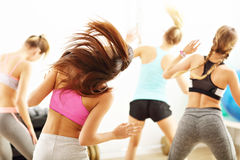 Group of happy people with coach dancing in gym Royalty Free Stock Photo