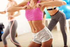 Group of happy people with coach dancing in gym royalty free stock photos