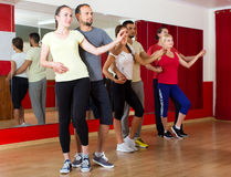 Group of happy people dancing salsa Royalty Free Stock Photography