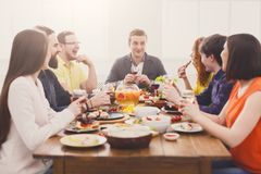 Group of happy people drink wine at festive table dinner party Royalty Free Stock Images