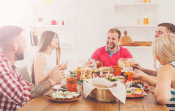 Group of happy people at festive table dinner party. Friends party. Small talk friendly conversation, young happy people company have fun together, festive Stock Images