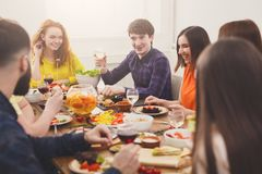 Group of happy people at festive table dinner party. Pretty girls talking. stock image