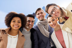 Group of happy people or friends on city street royalty free stock photography