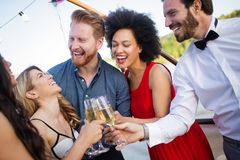 Group of happy people or friends having fun at party stock image