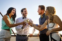 Group of happy people or friends having fun at party royalty free stock photos