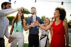 Group of happy people or friends having fun at party royalty free stock image
