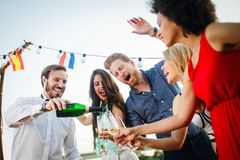 Group of happy people or friends having fun at party royalty free stock photography