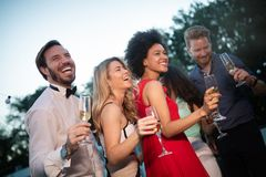 Group of happy people or friends having fun at party royalty free stock images