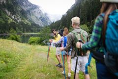 Group of happy young people friends hiking together outdoor stock photos