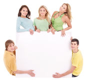 Group of happy people holding banner. Royalty Free Stock Image