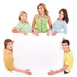 Group of happy people holding banner. Royalty Free Stock Photography