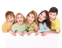 Group of happy people holding banner. Royalty Free Stock Images