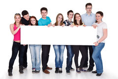 Group of happy people holding banner,  Royalty Free Stock Photo