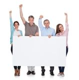 Group of happy people holding placard Stock Photo