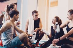 A group of happy people resting after a workout. royalty free stock images