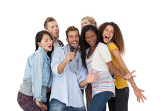 Group of happy people singing into microphone Royalty Free Stock Image