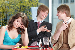 Group of happy people talking in cafe. Royalty Free Stock Photo
