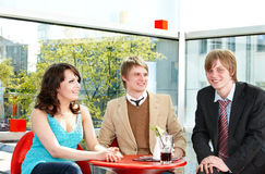 Group of happy people talking in cafe. Stock Photography