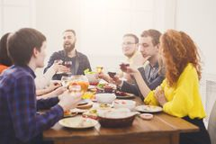 Group of happy people with wine glasses at festive table dinner party Stock Photo