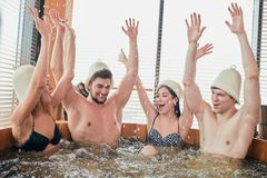 Group of caucasian diverse friends enjoying jacuzzi in hotel spa. Group of happy people young people having great time in spa, relaxing enjoying jacuzzi hot tub stock photography