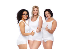 Group of happy plus size women showing thumbs up Stock Photo