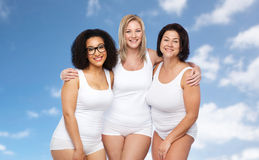 Group of happy plus size women in white underwear Stock Image
