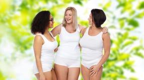 Group of happy plus size women in white underwear Stock Photo