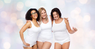 Group of happy plus size women in white underwear Royalty Free Stock Photo