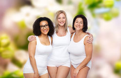 Group of happy plus size women in white underwear Stock Photo