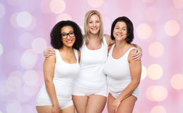 Group of happy plus size women in white underwear Royalty Free Stock Images