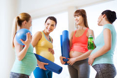 Group of happy pregnant women talking in gym Royalty Free Stock Images