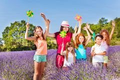 Cute kids playing with pinwheels in lavender field Royalty Free Stock Images