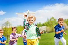 Group of happy running children with airplane toy Stock Photography