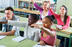 Group of happy school pupils  raise their hands up Royalty Free Stock Photography