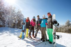 Group of skiers and boarders together on mountain. Group of happy skiers and boarders together on mountain Royalty Free Stock Photos